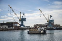 US Navy dockers in Portsmouth NH. US Navy dockers near the PNBY Tug Service building at the Portsmouth Naval Shipyard in New Hampshire Royalty Free Stock Images