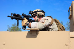 US Navy EOD aims rifle from humvee Royalty Free Stock Photos
