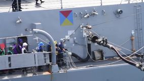 US Navy Fuel Pipe Connect Ship. A fuel pipe is connect at a other ship stock video footage