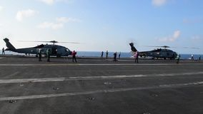 US Navy Helicopter On Flighdeck Carrier Running Engines stock video footage