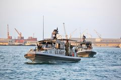 US NAVY inshore security patrolling in port of Djibouti. GULF OF ADEN, REPUBLIC OF DJIBOUTI FEBRUARY 06, 2016: US NAVY inshore security patrolling in port of Royalty Free Stock Photos