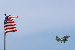 US Navy Jet with US Flag Stock Image