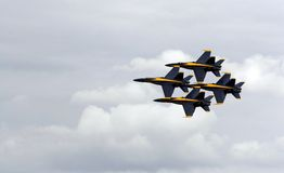 US Navy's Blue Angels. Four US Navy Blue Angels flying in a diamond formation at an airshow stock photos