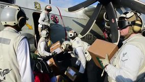 US Navy Sailers Load Aircraft. US Navy sailers load a aircraft at a carrier with packages stock video