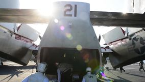 US Navy Sailers Load Aircraft. US Navy sailers load a aircraft at a carrier with packages stock video footage