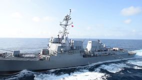 US Navy USS Stockdale Ship At Sea. The USS Stockdale drives in the Japan sea at a sunny day. It drives below a tanker ship stock video