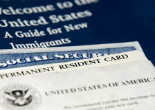 US new resident documents. US permanent resident card (Green Card) seen with welcome to the USA brochure