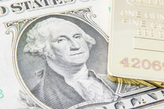 US one dollar bill with image / portrait of George Washington and gold bullion. Royalty Free Stock Photo