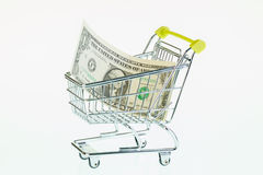 US one dollar bill in shopping cart Stock Photos