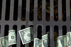 US One Dollar bills flushed down the drain, copy space. US Dollar bills down the drain Stock Images