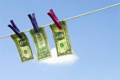 US one dollar bills hanging on washing line, money laundering concept Stock Photo
