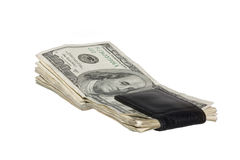 US One Hundred Dollar Bills in Black Money Clip. The money is faded and worn stock photo
