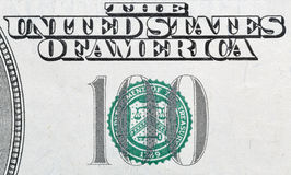 US one hundred dollars bill closeup macro. Stamp of the Department of The Treasury on US one hundred dollars bill closeup macro Stock Image