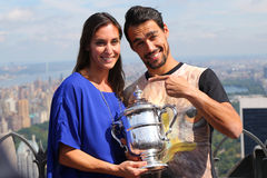 US Open 2015 champion Flavia Pennetta and tennis player Fabio Fognini posing with US Open trophy on the Top of the Rock Royalty Free Stock Image