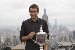 US Open 2014 champion Marin Cilic posing with US Open trophy on the Top of the Rock Observation Deck at Rockefeller Center Royalty Free Stock Photo