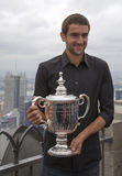 US Open 2014 champion Marin Cilic posing with US Open trophy on the Top of the Rock Observation Deck at Rockefeller Center Royalty Free Stock Photography