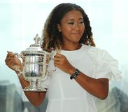 2018 US Open champion Naomi Osaka of Japan poses with US Open trophy on the Top of the Rock Observation Deck at Rockefeller Center Royalty Free Stock Images