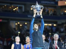 2018 US Open champion Novak Djokovic of Serbia posing with US Open trophy during trophy presentation after his final match victory Stock Images