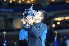 2018 US Open champion Novak Djokovic of Serbia posing with US Open trophy during trophy presentation after his final match victory Royalty Free Stock Photo