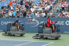 US Open cleaning crew drying tennis court after rain delay at Louis Armstrong Stadium at Billie Jean King National Tennis Center Stock Photography