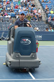 US Open cleaning crew drying tennis court after rain delay at Louis Armstrong Stadium at Billie Jean King National Tennis Center Royalty Free Stock Photography