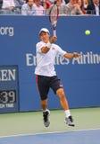 US Open 2014 finalista Kei Nishikori podczas definitywnego dopasowania przeciw Marin Cilic przy Billie Cajgowego królewiątka teni obraz stock