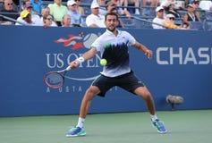 US Open 2014 kampioen Marin Cilic van Kroatië tijdens US Open 2014 ronde gelijke 4 Stock Foto's