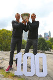 US Open 2014 men doubles champions Bob and Mike Bryan posing with trophy in Central Park Royalty Free Stock Photos