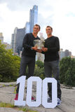 US Open 2014 men doubles champions Bob and Mike Bryan posing with trophy in Central Park Royalty Free Stock Image