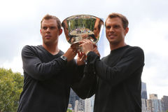 US Open 2014 men doubles champions Bob and Mike Bryan posing with trophy in Central Park Stock Photography
