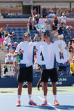 US Open 2014 men doubles champions Bob and Mike Bryan during trophy presentation at Billie Jean King National Tennis Center Royalty Free Stock Images