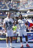 US Open 2013 men doubles champions Radek Stepanek from Czech Republic and Leander Paes from India during trophy presentation Royalty Free Stock Images