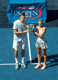 US Open 2013 mixed doubles champions Max Mirniy from Belarus and Andrea Hlavackova from Czech Republic during trophy presentation Royalty Free Stock Photos