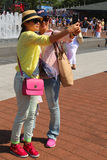 US Open 2014 visitors taking selfie at Billie Jean King Tennis Center Royalty Free Stock Images