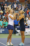 US Open 2014 women doubles champions Ekaterina Makarova and Elena Vesnina during trophy presentation Stock Images