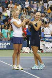 US Open 2014 women doubles champions Ekaterina Makarova and Elena Vesnina during trophy presentation Royalty Free Stock Photo