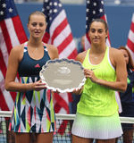 US Open 2016 women doubles runners up Kristina Mladenovic (L) and  Caroline Garcia of France during trophy presentation Stock Photo