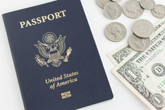 US passport and coins Royalty Free Stock Images
