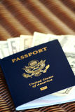 US Passport and dollar bills. American passport with various denominations of US dollar bills Stock Image