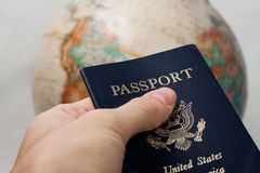A US passport holder traveling the world. A US passport holder hands his passport off to the world stock images