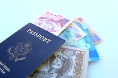 US passport and multinational currencies Stock Photo
