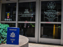 US Passport Services. US Passport in front of United States Department of State Passport Services office in New York City. A business man in a suit (minus the Royalty Free Stock Photos