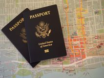 US Passports on Colorful Map Stock Image