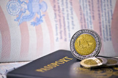 US Passports with Mexican Coins Royalty Free Stock Photos