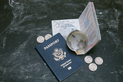 US passports and small glass globe on black background Royalty Free Stock Photo