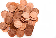 US Pennies. A pile of US pennies isolated on a white background with copy space Stock Image