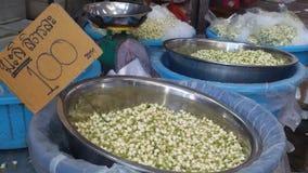 2.7 US.  per liter. Jasmine at the wholesale flowers market in bangkok thailand Stock Image