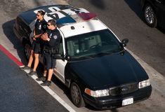 US police officer on duty at the police car in Hollywood royalty free stock image