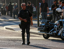 US policeman patrols city street Stock Photography