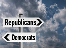 US politics - Republicans and Democrats. Republicans and democrats facing different directions over stormy background Royalty Free Stock Image
